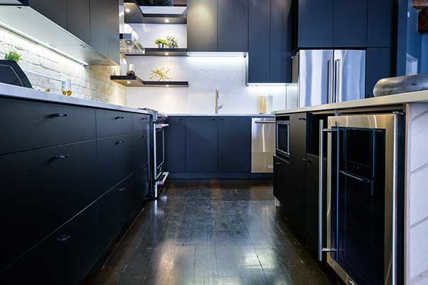 Winnipeg Downtown apartment. Black kitchen cabinets.