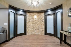 Basement hallway with curved wall.