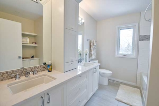 Lights colors, white cabinets and pure simplicity in Winnipeg bathroom.