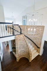 Stylish brick staircase with dark wood railings.